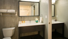 Enjoy the luxury and amenities of the bathroom in our Deluxe One Bedroom Suite bathroom. All bathrooms at Hotel Azure feature toiletries from Paya.