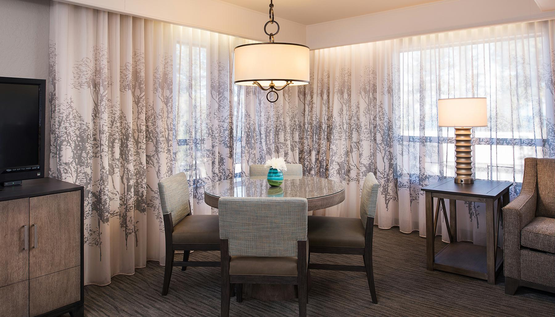 Deluxe One Bedroom Suite Dining Room Table