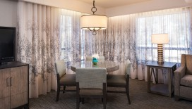 Gather around the Deluxe One Bedroom Suite's dining table to share a meal or plan your next day in South Lake Tahoe.